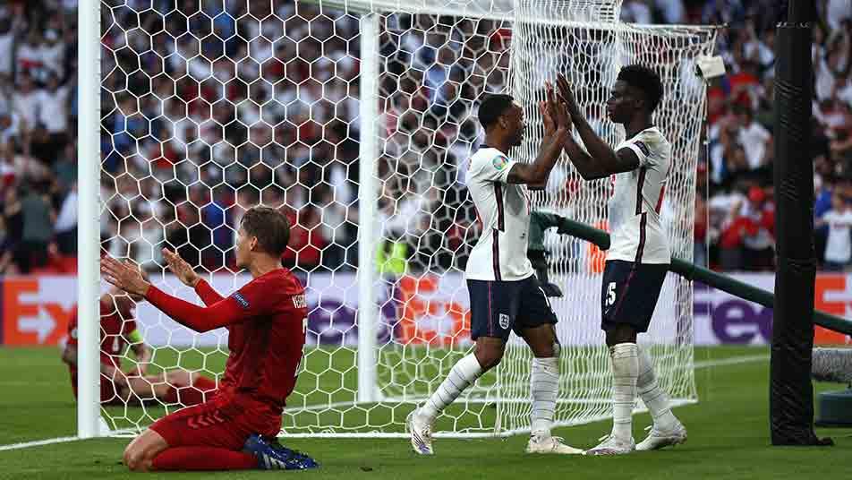 Raheem celebrates with Bukayo Saka after England's first-half equaliser