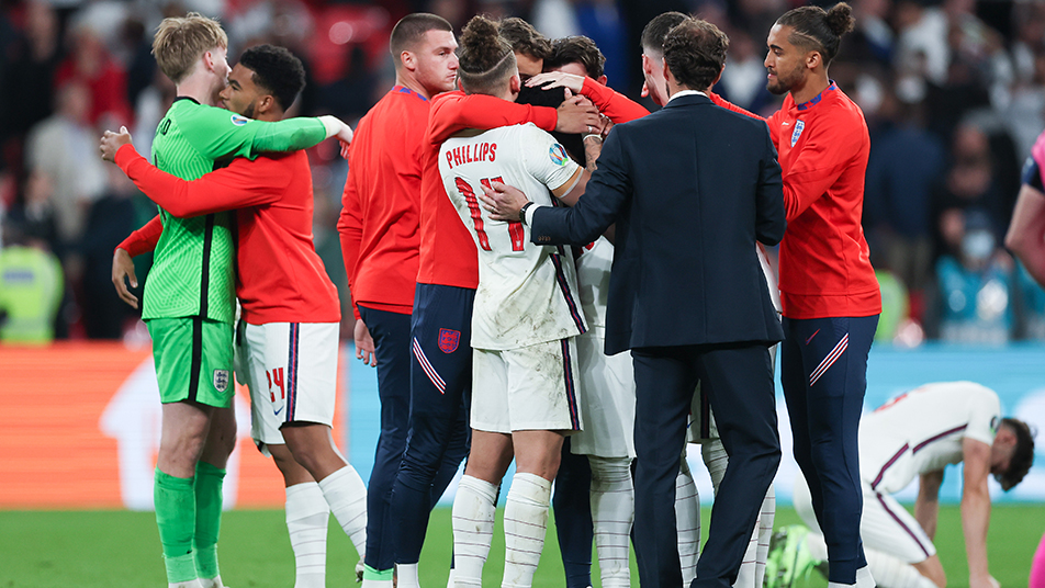 England's Bukayo Saka is consoled by his squad mates and Southgate following defeat to Italy
