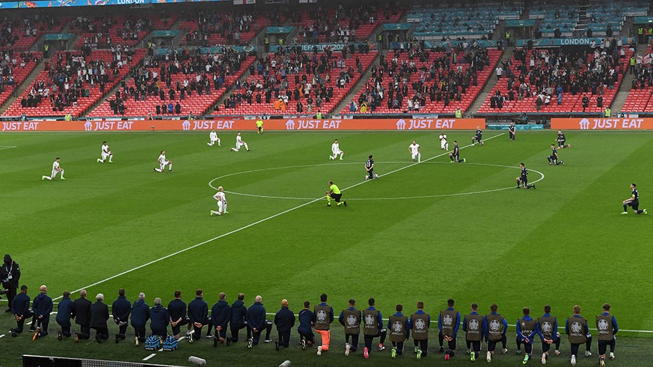 England and Scotland players taking the knee during UEFA Euro 2020