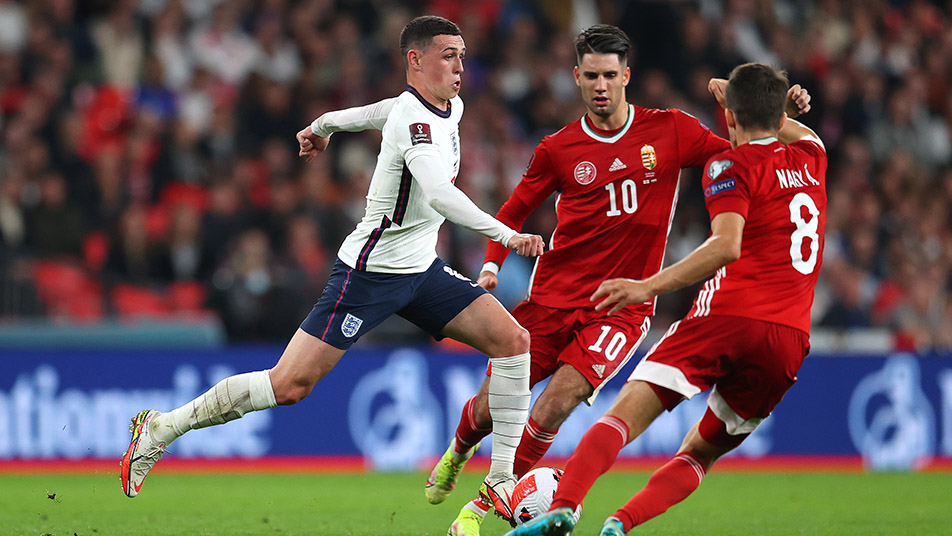 Phil Foden in full flow, as he evades the attention of two Hungarian defenders