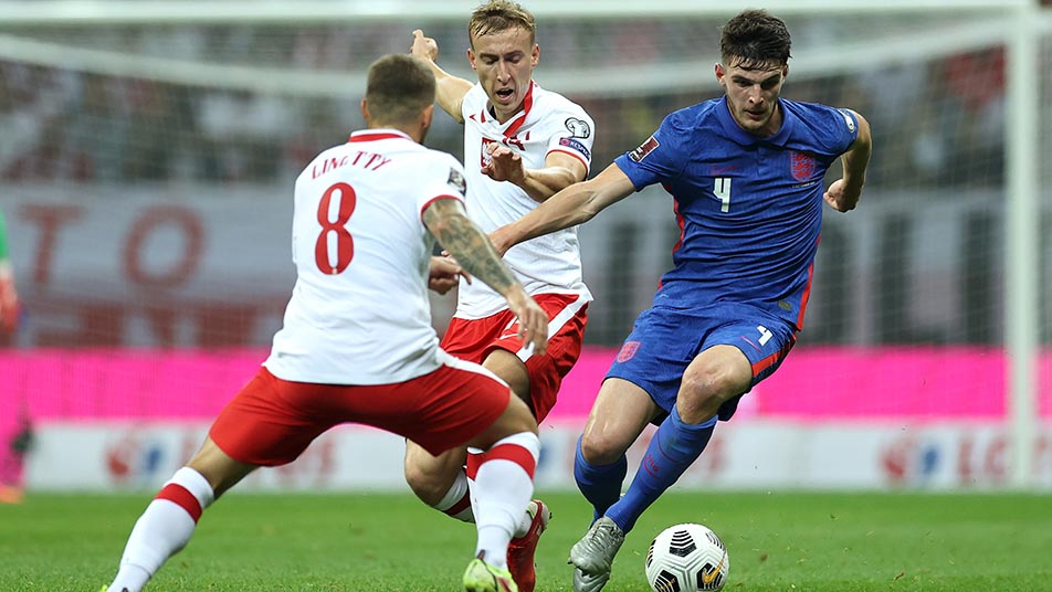 Declan Rice looks to take control of the midfield in Warsaw