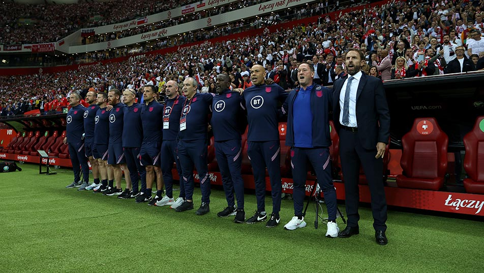 Gareth Southgate and his coaching staff before the game with Poland