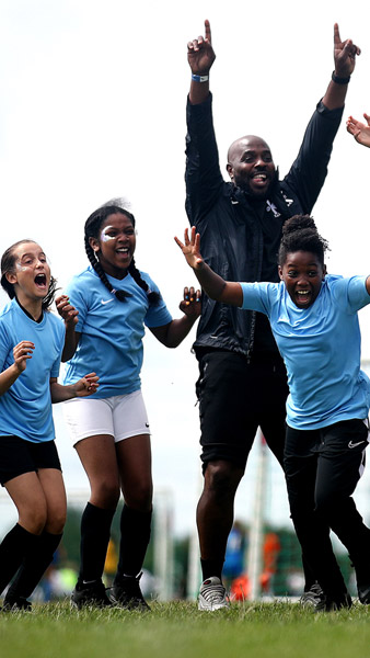 A team celebrate at Hackney Marshes
