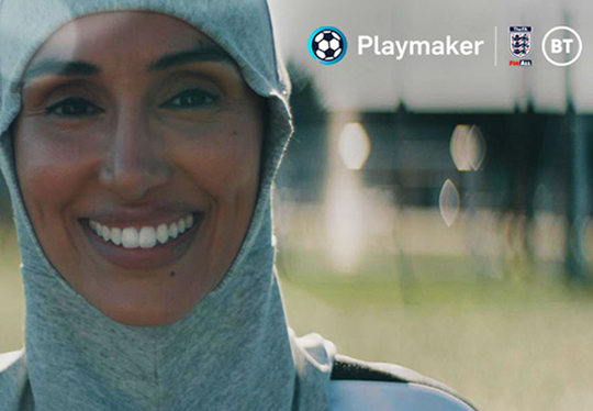 playmaker-female-coach-smiling